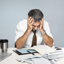 Man Stressed with Papers